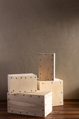 Stack of wooden cube or plywood box block near wall background texture. Abstract construction...