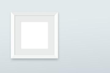 Fototapeta Biała ramka do zdjęć na jasnym tle obraz