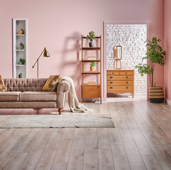 Pink and white brick wall background bookshelf wooden cabinet and green plant, interior style.