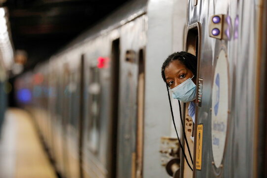 An MTA worker is seen on the subway after The Port Authority of New York and New Jersey and the Metropolitan Transportation Authority (MTA) announced a mandatory coronavirus vaccination or weekly test mandate for employees in New York City, New York