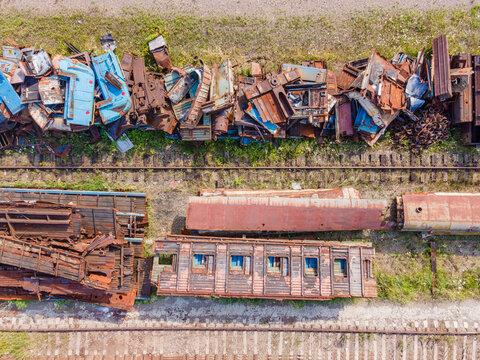 Railway trains, scrap metal dump at the railway station, top view