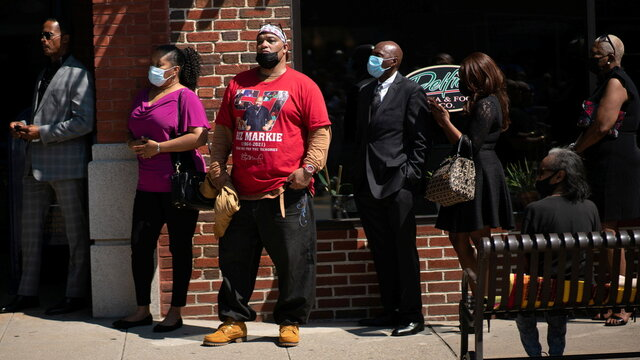 People wait outside Patchogue Theatre during the funeral for late rapper Marcel Theo Hall, known by his stage name Biz Markie, in Patchogue, New York
