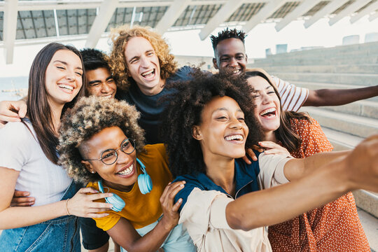 International group of young multicultural people taking selfie portrait with smart phone - Best friends having fun together on holidays - Friendship lifestyle and unity concept - Focus on afro woman