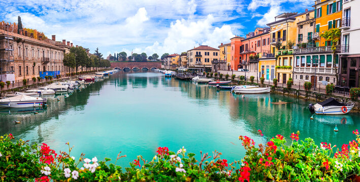 Peschiera del Garda - charming village with colorful houses in beautiful lake Lago di Garda. Verona province, northern Italy