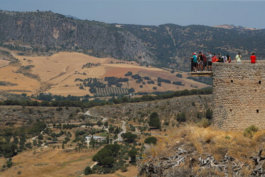 Tourists look at the landscape from a balcony amid the coronavirus disease (COVID-19) outbreak in Ronda