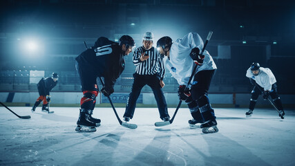 Ice Hockey Rink Arena Game Start: Two Players Brutal Face off, Sticks Ready, Referee is Going to Drop the Puck, Athletes Ready to Fight. Intense Game Wide of Energy Competition, Speed.