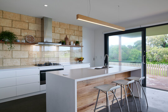 Modern kitchen interior with glass splashback