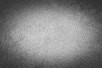 Gray decorative plaster texture with vignette. Abstract grunge background with copy space.