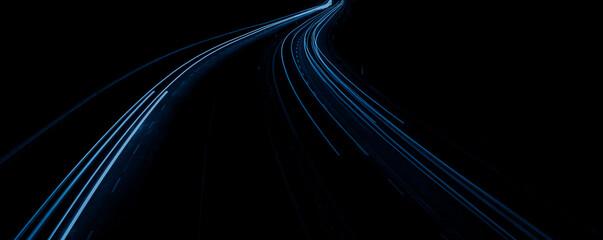 blue car lights at night. long exposure