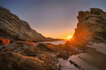 Beautiful scenery of cliffs by the sea at sunse