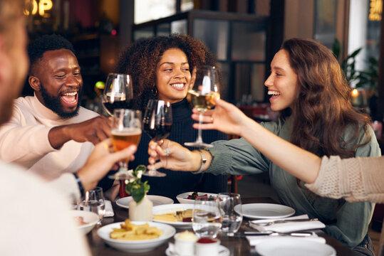 Friends raising glasses in restaurant