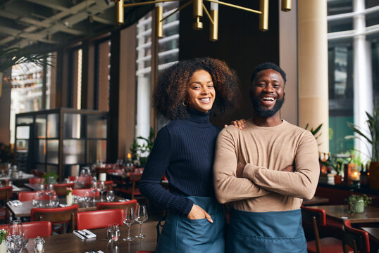 Cheerful small business partners in restaurant