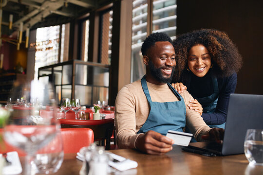 Restaurant owners using credit card online