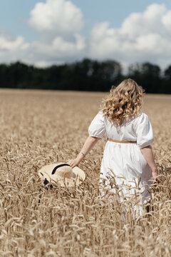 girl runs through a wheat field. High quality photo