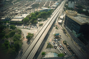 Busy highway road junction in metropolis city center . Transportation and infrastructure concept .