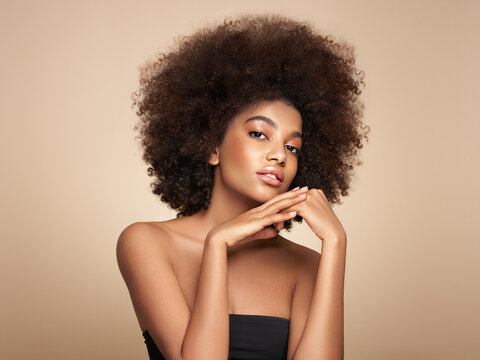 Beauty portrait of African American girl with afro hair. Beautiful black woman. Cosmetics, makeup and fashion