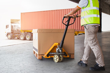 Warehouse Worker Unloading Package Box to Cargo Container. Delivery. Truck Loading at Dock Warehouse. Cargo Shipments. Shipping Warehouse Logistics and Transportation.