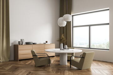 Bright dining room interior with large window with countryside view