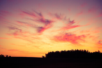 A beautiful evening scenery of a rural landscape. Sunset in the country landscape. Summertime scenery of Northern Europe.