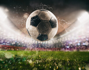 Close up of a soccer ball kicked with power at the stadium