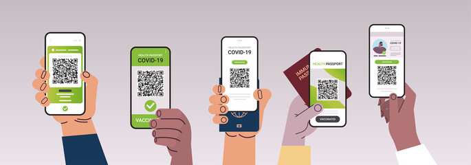 hands holding smartphones with digital vaccinate certificates and global immunity passports
