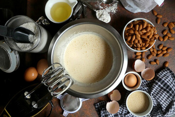 High Angle View Of Making Cake With Ingredients On Table