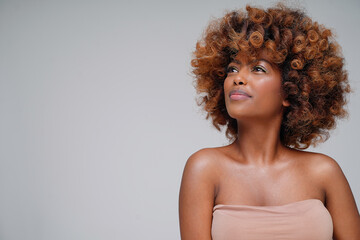 Beauty portrait of young attractive afro woman with perfect skin and delicate glamour makeup