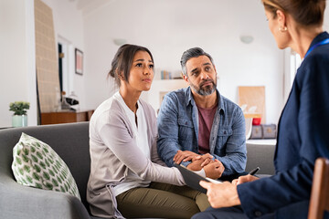 Worried couple meeting social counselor