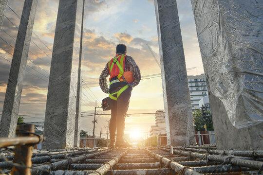 Construction worker wearing safety work at high uniform