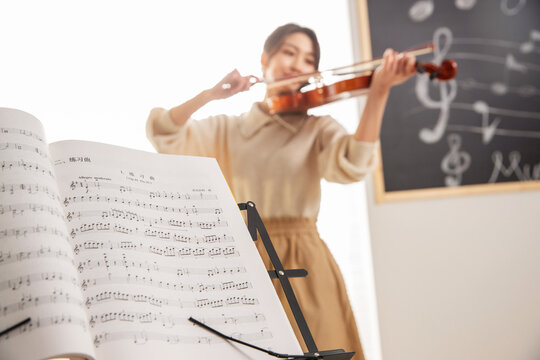 The young woman playing the violin