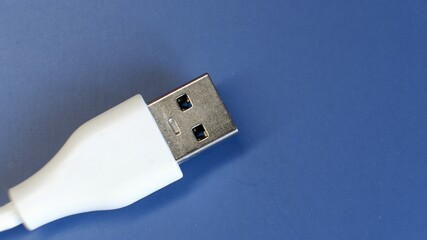 White USB connector on blue background