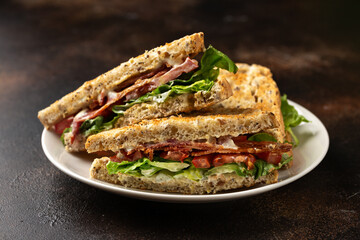 Fresh BLT Sandwiches with Bacon Lettuce and Tomato on white plate