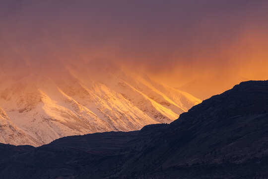 Sunrise over snow covered mountains in Patagonia, Chile