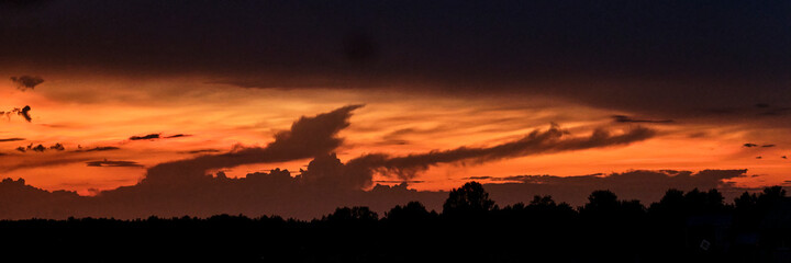 Beautiful dramatic sunset in yellow-red and orange colors.