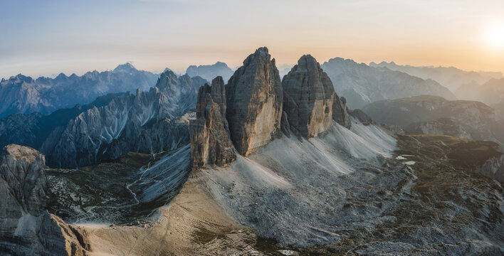Beautiful aerial view to Tre Cime peaks at sunset, Dolomites, Italy
