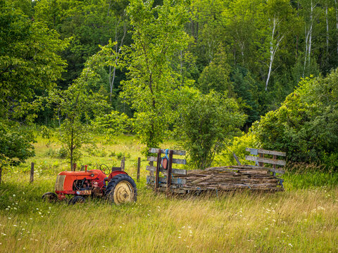 old tractor and wagon in field