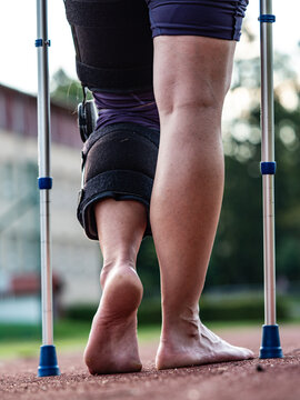Hurt runner walk by crutches on track after competition