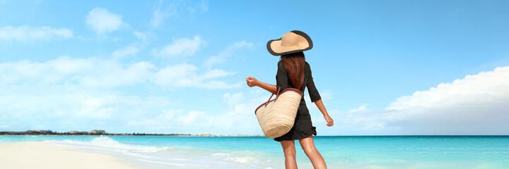 Beach vacation luxury travel woman tourist walking on pristine resort holiday hotel waterfront...