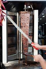 While cutting Turkish meat doner kebab