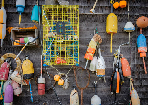 Old collected Lobster Pot floats hanging on a wooden Lobster shack