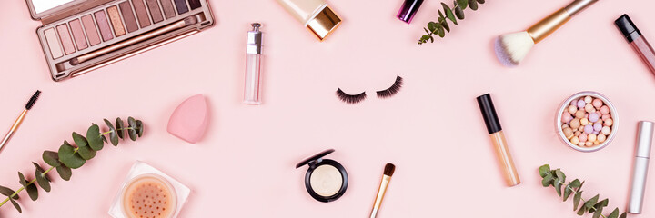 Flat lay of professional Cosmetics set on pastel pink background. Female facial beauty care products
