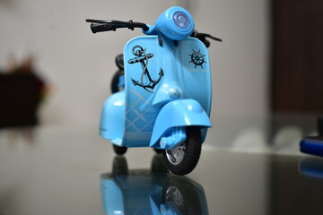Vintage Cars & Scooter Toys on Reflective Surface