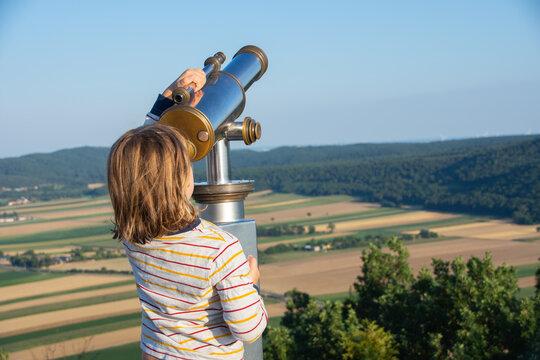Child at a telescope in Austria