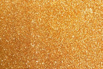 Beautiful shiny golden glitter as background, closeup