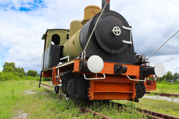 Antique train or ancient railway, head part are on the tracks for an industrial steam locomotive.