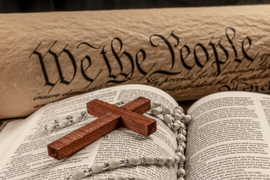 Holy bible and small cross with the constitution