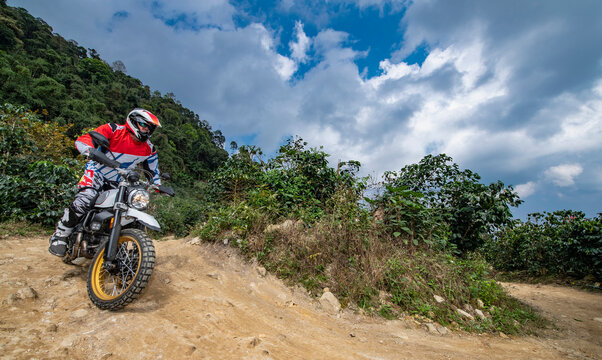 senior adult riding his dirt bike in the hills around Chiang Mai
