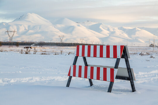 Warning sign with red lines on snow in winter