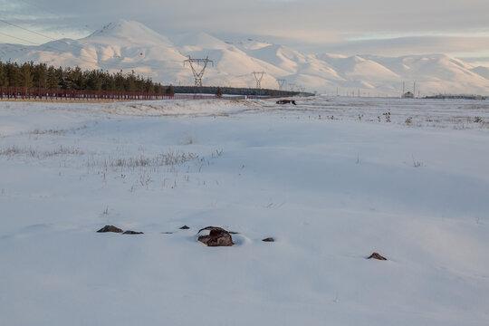 Stones on snow with Palandoken mountains in Erzurum, Turkey