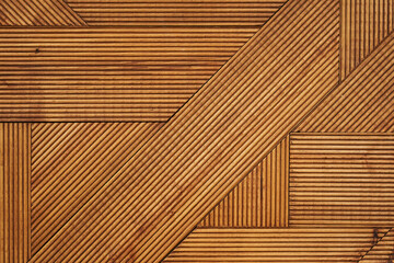 wood texture. fibrous wood texture with geometric patterns. wooden figures stacked in the background. wood background